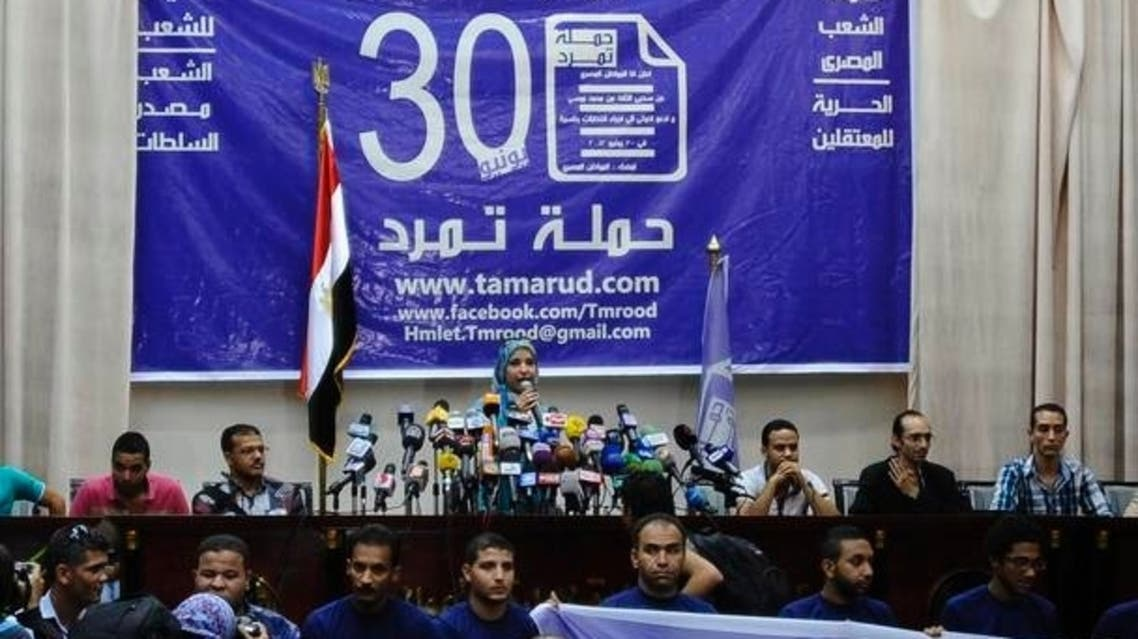 "Members of the ""Tamarod"" movement hold a news conference at their headquarters in Cairo"