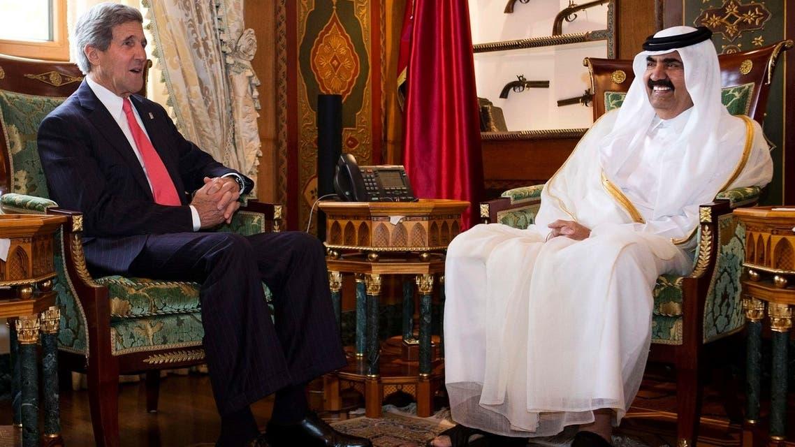 U.S. Secretary of State John Kerry (L) meets with Qatari Emir Hamad bin Khalifa Al Thani at Wajbah Palace in Doha June 23, 2013.