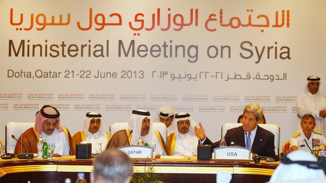 """U.S. Secretary of State John Kerry (R) speaks during the London 11 countries """"Friends of Syria"""" meeting in Doha June 22, 2013. (Reuters)"""