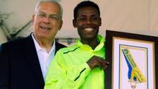 Boston Marathon winner returns his medal to city