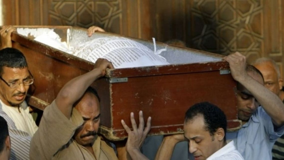Egyptians carry the coffin of a Shiite following funeral prayers in Cairo on Monday, June 24. (Photo courtesy: AP)