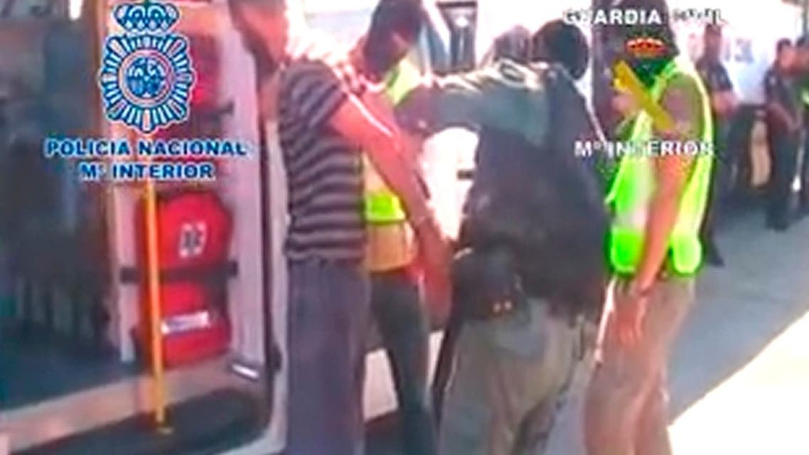 An image grab taken from a handout video released on June 22, 2013 by the Spanish Interior Ministry shows members of the Spanish security forces detaining one of the eight unidentified suspected terrorists arrested in Ceuta on June 21. (AFP)