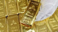 Gold prices near 3-year low on strong U.S. economic data