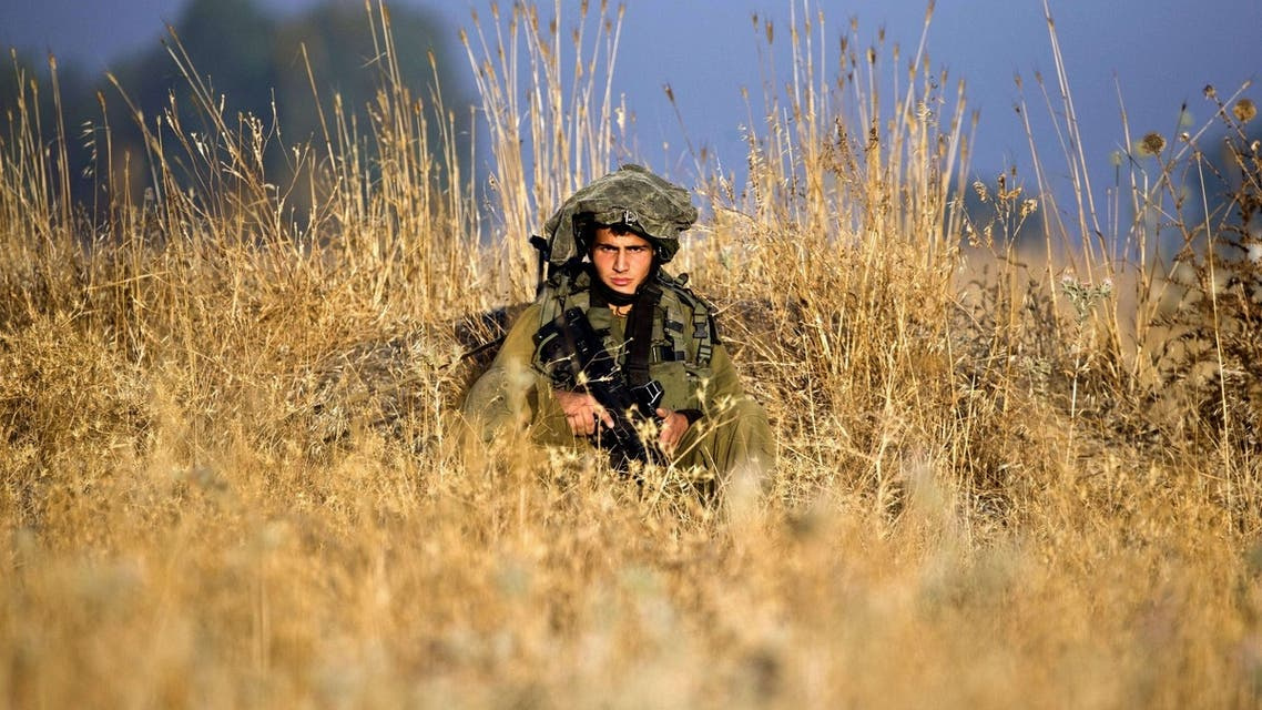 Israeli soldiers from the Golani Brigade take part in a military exercise in the Israeli-annexed Golan Heights near the border with Syria on June 26, 2013.