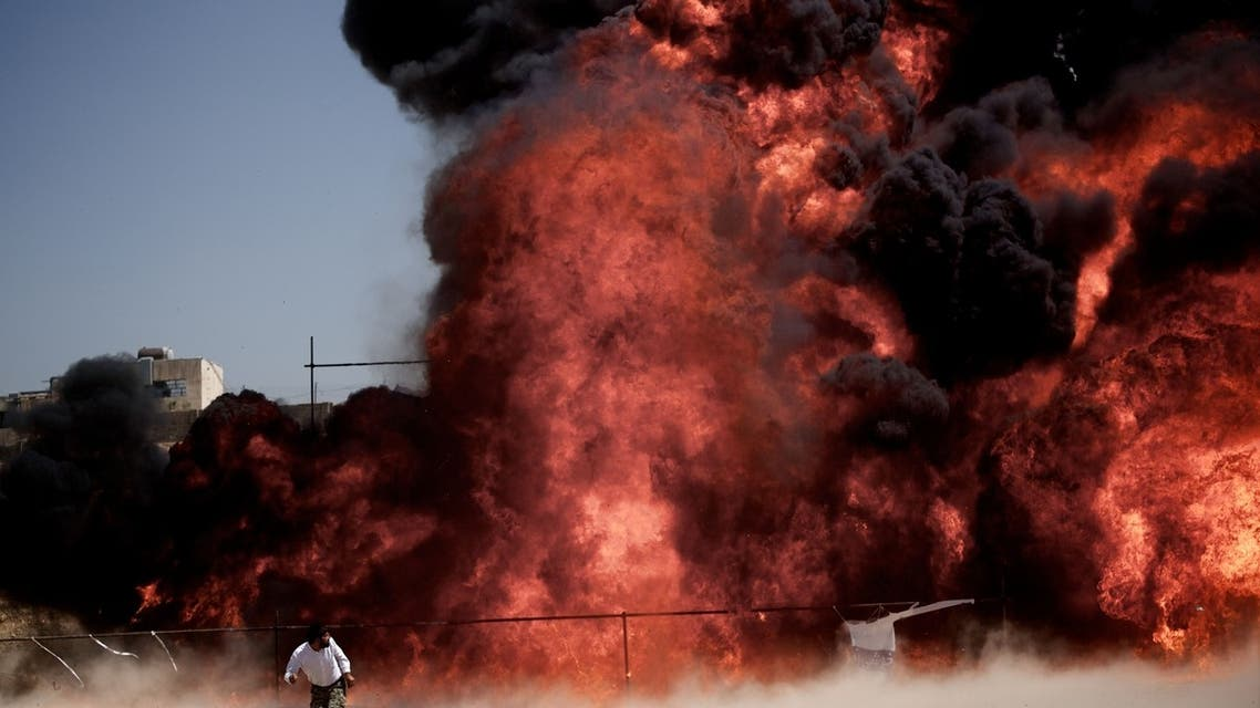 An Iranian man who was fixing explosives wires run away after setting ablaze 50 tons of drugs seized in recent months in eastern Tehran on June 26,2013.  (AFP)