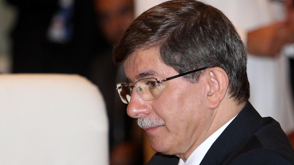"""Turkish Foreign Minister Ahmet Davutoglu attends the """"Friends of Syria"""" meeting in the Qatari capital Doha on June 22, 2013. (AFP)"""