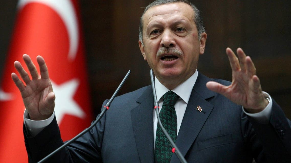 Turkish Prime Minister Recep Tayyip Erdogan addresses members of parliament from his ruling Justice and Development Party (AKP) during a meeting at the Turkish parliament in Ankara on June 25, 2013. AFP