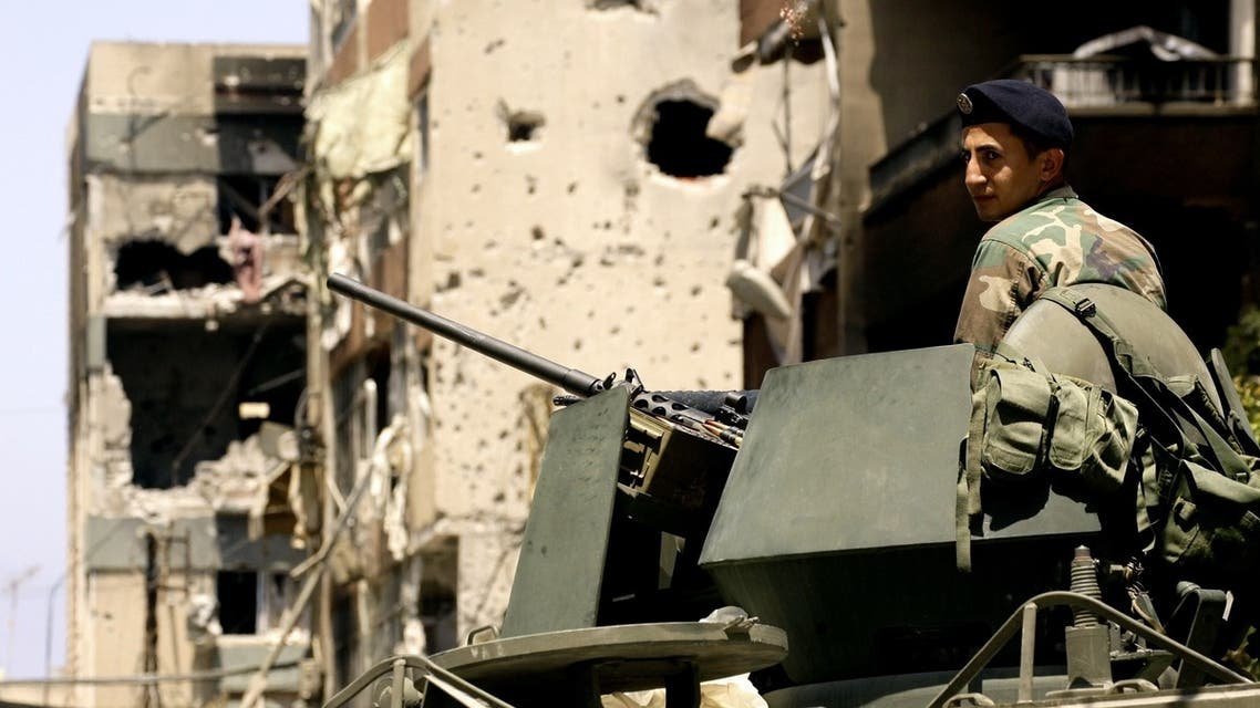 A Lebanese soldier monitors the area outside the Bilal bin Rabah mosque, scene of this week's deadly clashes between the Lebanese army and supporters of radical Sunni cleric Sheikh Ahmad al-Assir, in the Abra district of the southern city of Sidon on June 28, 2013. AFP