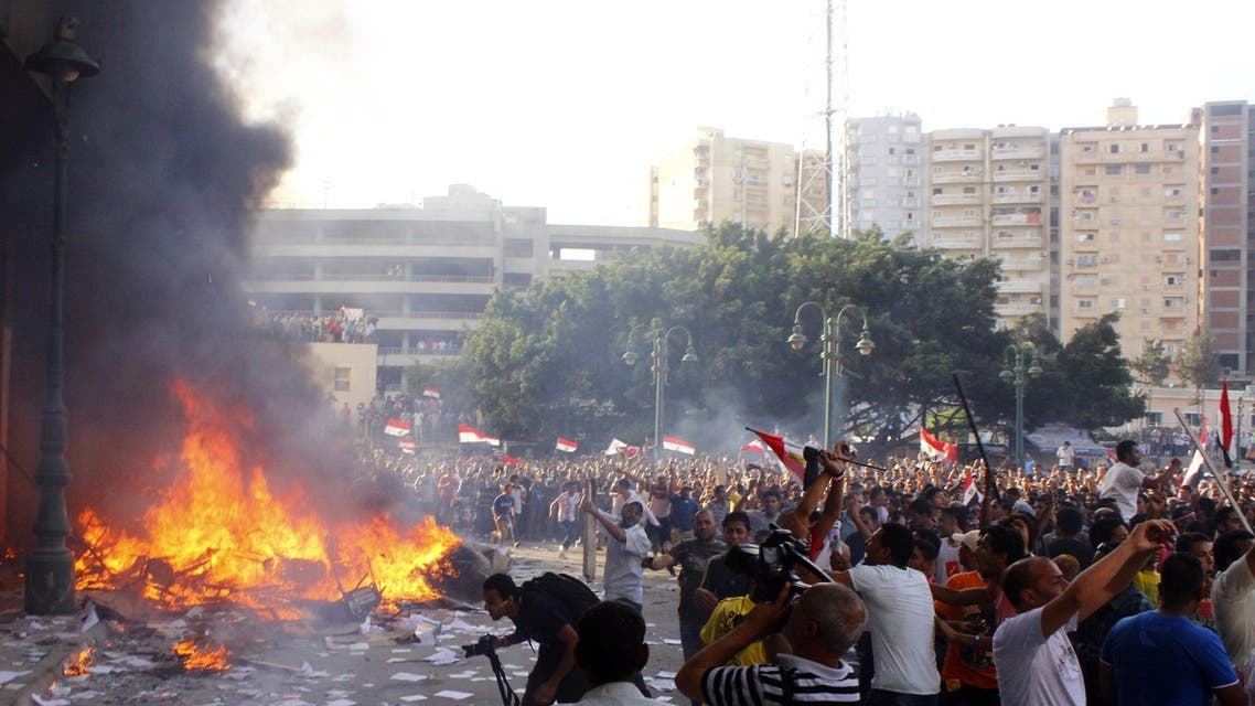 Opponents of Egyptian President Mohamed Mursi burn the content of a Freedom and Justice Party office in the coastal city of Alexandria on June 28, 2013. (AFP)