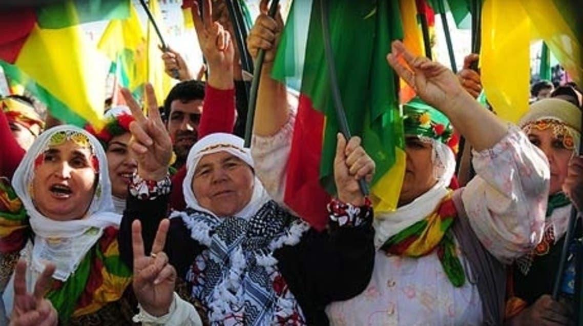 Kurdish women protest holding PKK flag