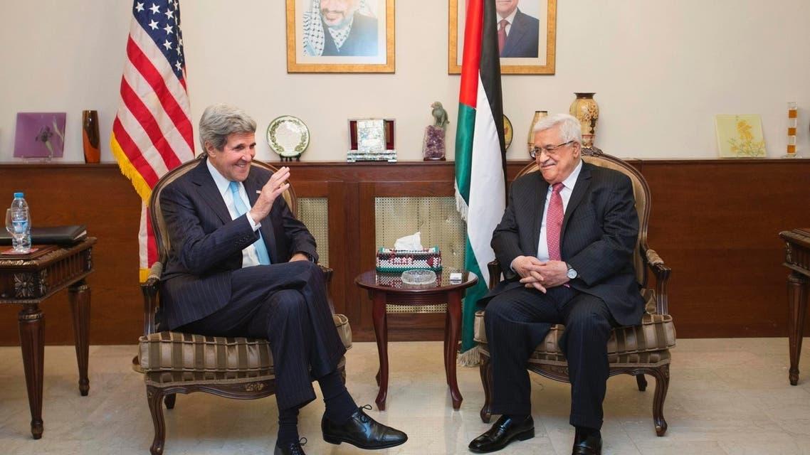 U.S. Secretary of State John Kerry (L) speaks with Palestinian President Mahmoud Abbas in Amman June 28, 2013.
