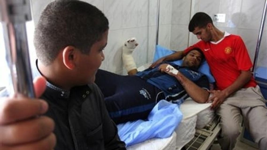 A man lies on a hospital bed after being wounded during one of two bomb attacks in the city of Baquba, about 50 km (31 miles) northeast of Baghdad, June 28, 2013.