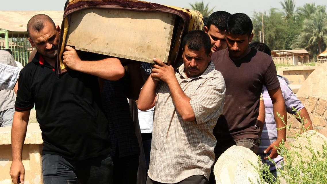 Relatives carry the coffin of a victim killed in one of two bomb attacks in Baquba, about 50 km northeast of Baghdad, during a funeral, June 28, 2013. (Reuters)