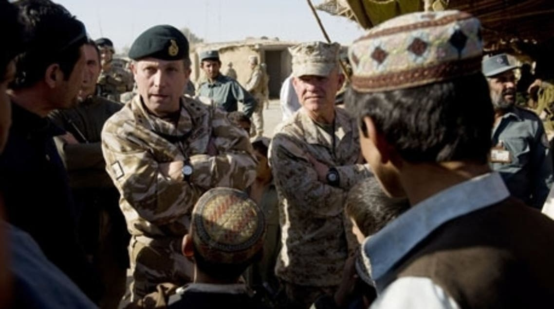 General Nick Carter (L) chats with Afghan men in Helmand province in Afghanistan in 2009. (AFP)