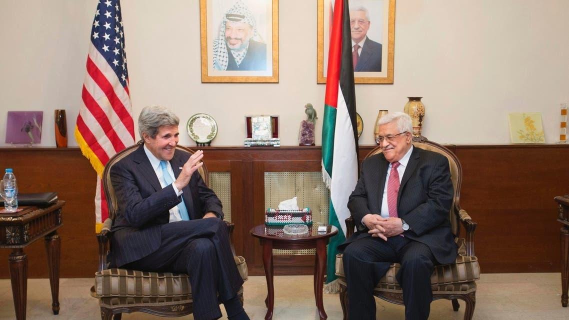 U.S. Secretary of State John Kerry (L) speaks with Palestinian President Mahmoud Abbas in Amman June 28, 2013. REUTERS