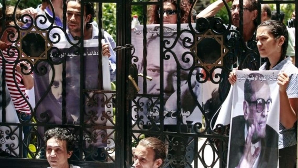 Intellectuals and artists protesting against President Mohammed Mursi carry pictures of popular Egyptian artists and writers in front of the Ministry of Culture in Cairo to demonstrate against what they claim is the increasing influence of the Muslim Brotherhood over the ministry, June 9, 2013.