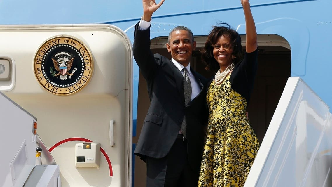 U.S. President Barack Obama and first lady Michelle Obama wave from Air Force One as they depart Dakar, Senegal, June 28, 2013.