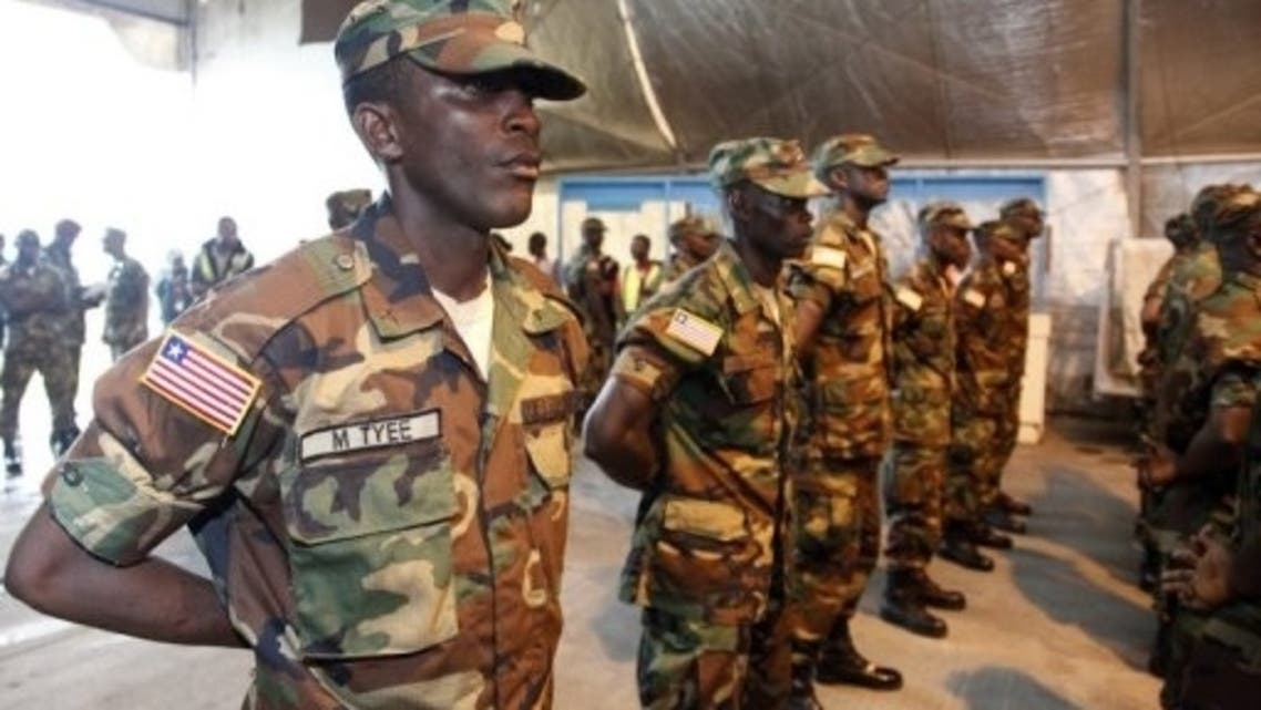 Liberian troops stand in rows in Monrovia before embarking on a peacekeeping mission to Mali, on June 20, 2013. (AFP)