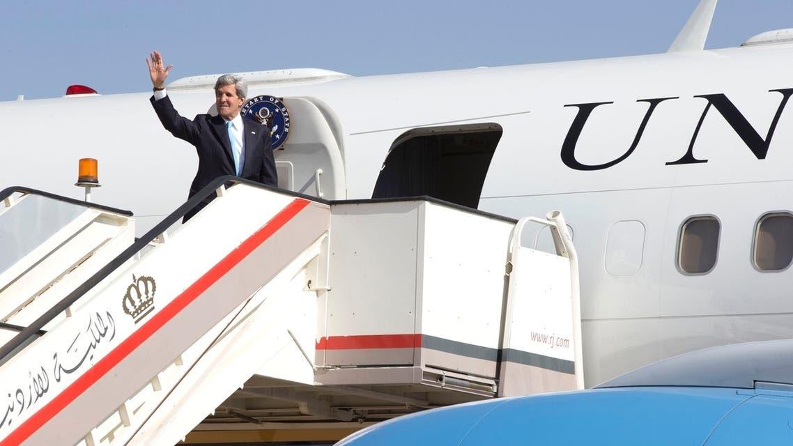 U.S. Secretary of State John Kerry waves as he boards his plane in Amman, Jordan, to return once again to Jerusalem, June 29, 2013. (Reuters)