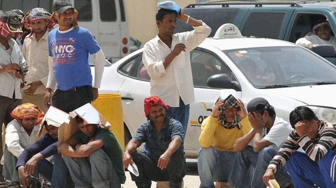Foreign illegal labourers wait in a long queue outside the Saudi immigration offices at Al Isha quarter of Al Khazan district, west of Riyadh, on Tuesday (AFP photo)