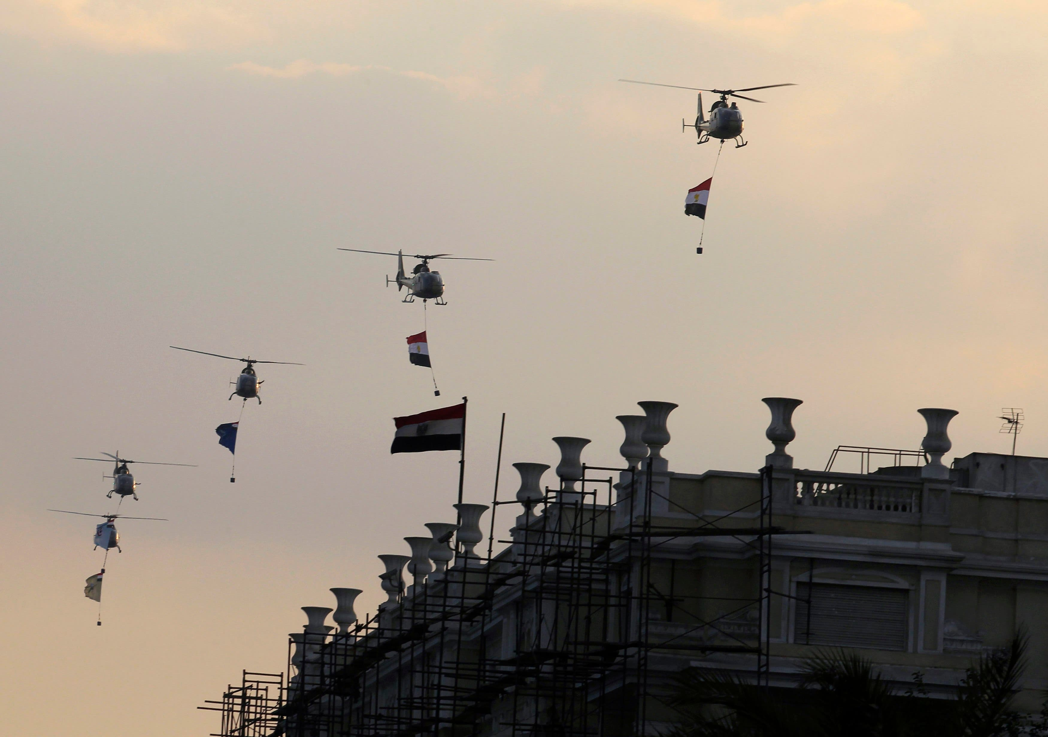 Military helicopters fly above Tahrir Square while protesters opposing Egyptian President Mohamed Mursi shout slogans against him and Brotherhood members during a protest, in Cairo July 1, 2013. (Reuters)