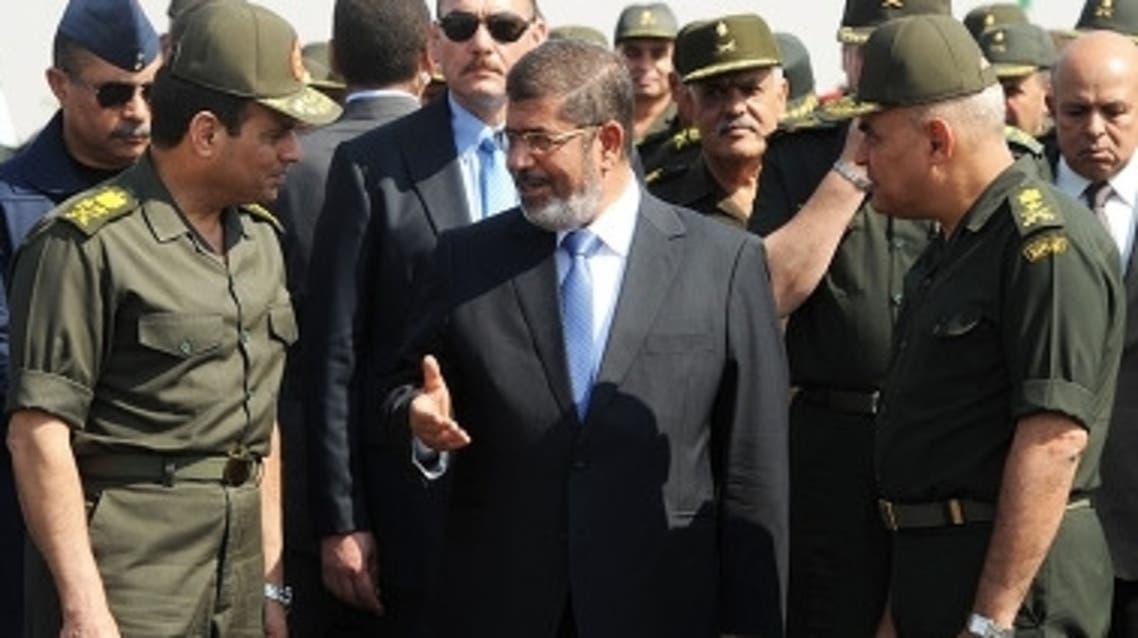 محمد مرسي وعبد الفتاح السيسي
