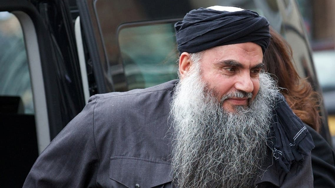 A file picture taken on November 13, 2012, shows Terror suspect Abu Qatada arriving at his home in northwest London, after he was released from prison. AFP