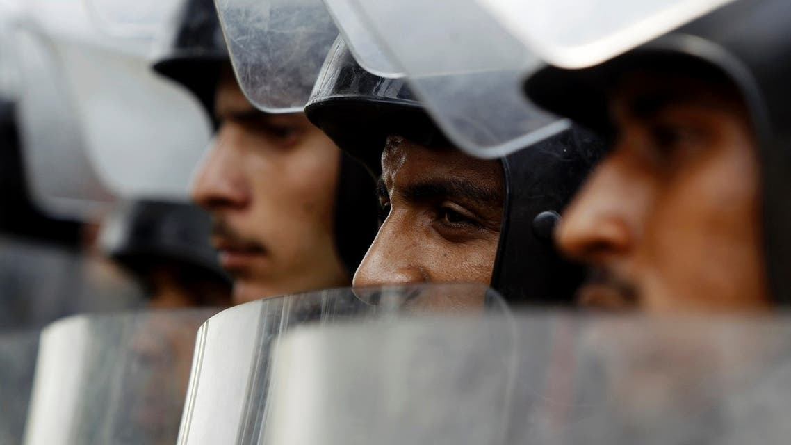Riot police stand with their shields as members of the Muslim Brotherhood and supporters of ousted Egyptian President Mohamed Mursi protest in front of Egypt's Constitutional Court during the swearing in ceremony of Adli Mansour as the nation's interim president in Cairo July 4, 2013. (Reuters)