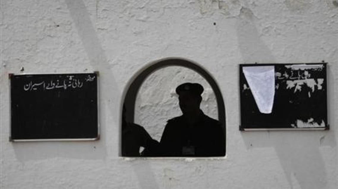 Policemen are seen silhouetted at the entrance of the Sargodha jail in Punjab province on June 24, 2010. (Reuters)