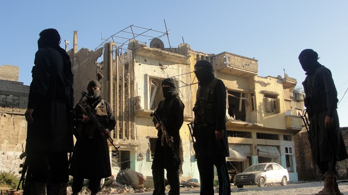 A handout picture released by the opposition-run Shaam News Network on July 2, 2013 shows rebel fighters scouting the area in Syria's central city of Homs. AFP
