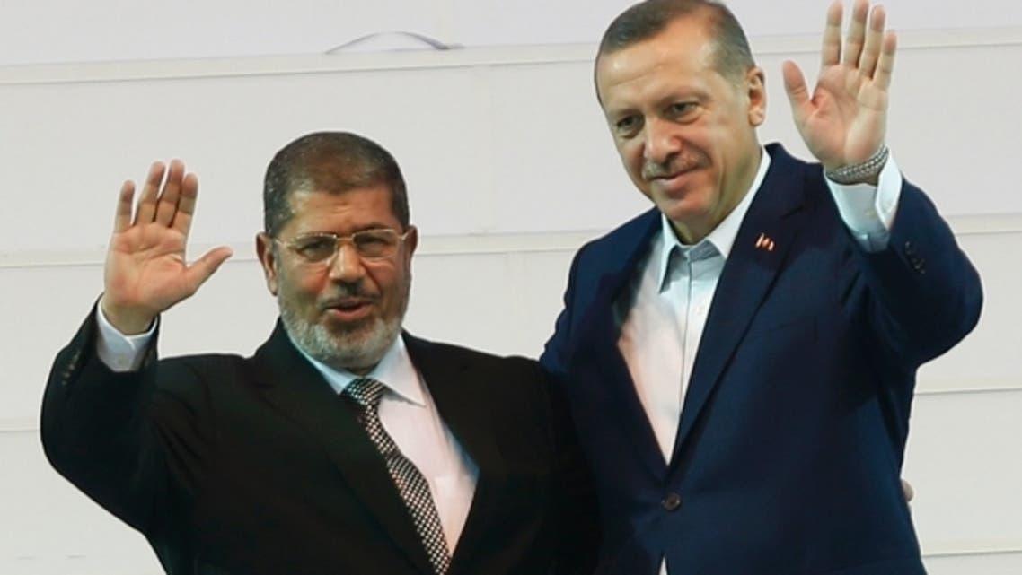 urkish Prime Minister Recep Tayyip Erdogan (right) and Egyptian President Mohammed Morsi greet the audience in Ankara, Sept. 30, 2012. Reuters