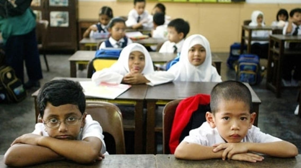 hildren attend their first day of elementary school in Standard One (Primary One) at a local school on the start of the new school year in Kuala Lumpur. Photograph: AFP