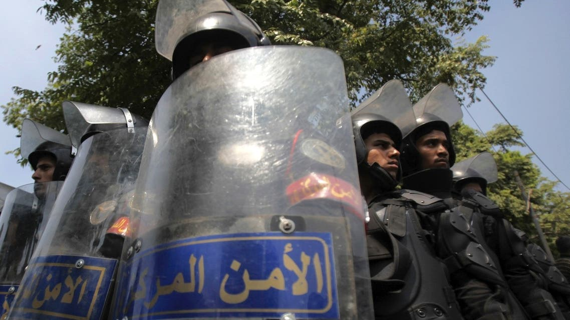 Riot police stand with their shields as members of the Muslim Brotherhood and supporters of ousted Egyptian President Mohamed Mursi protest in front of Egypt's Constitutional Court. (Reuters)
