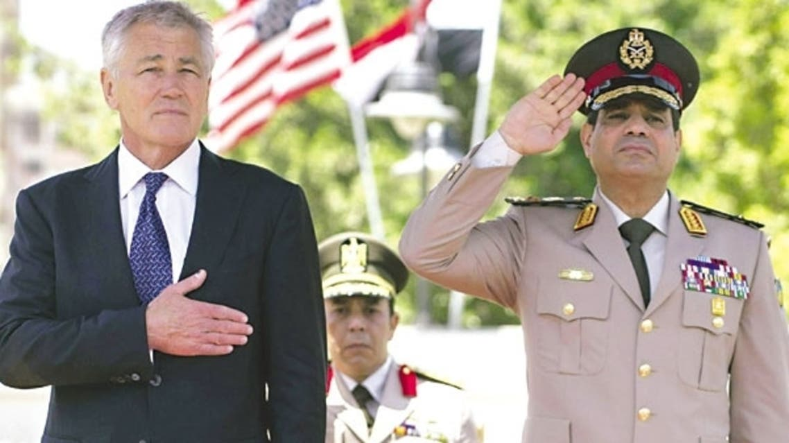 10:31 PM 24 April 2013  US Defence Secretary Chuck Hagel stands next to Egyptian Defence Minister General Abdel Fattah al-Sissi during an arrival ceremony at the defence ministry in Cairo yesterday.