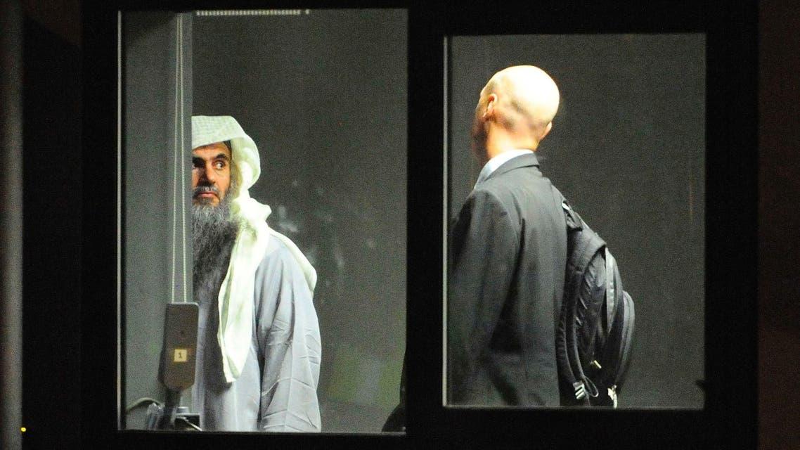 Muslim cleric Abu Qatada (L) prepares to board a small aircraft bound for Jordan during his deportation, at Royal Air Force base Northolt in London July 7, 2013