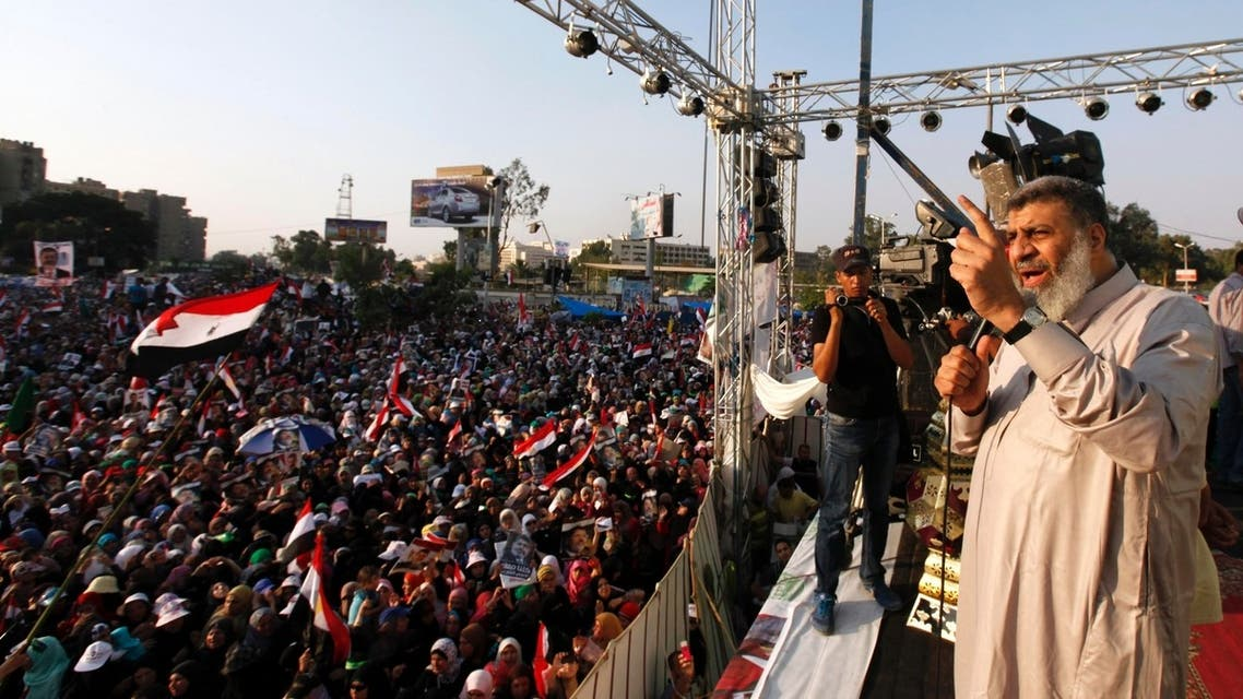Brotherhood leader Asem Abd-ElMaged delivers a speech to supporters of deposed Egyptian President Mohamed Mursi shout slogans during a protest in Cairo July 7, 2013. (Reuters)