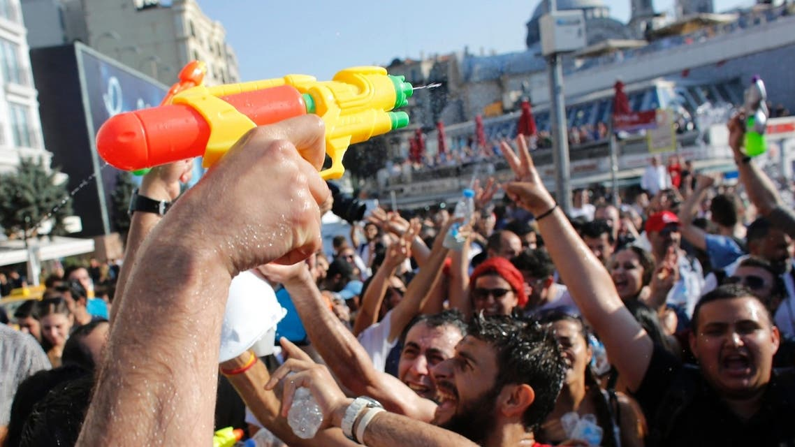 Demonstrators shout slogans as they spray water on each other in central Istanbul July 6, 2013. (Reuters)