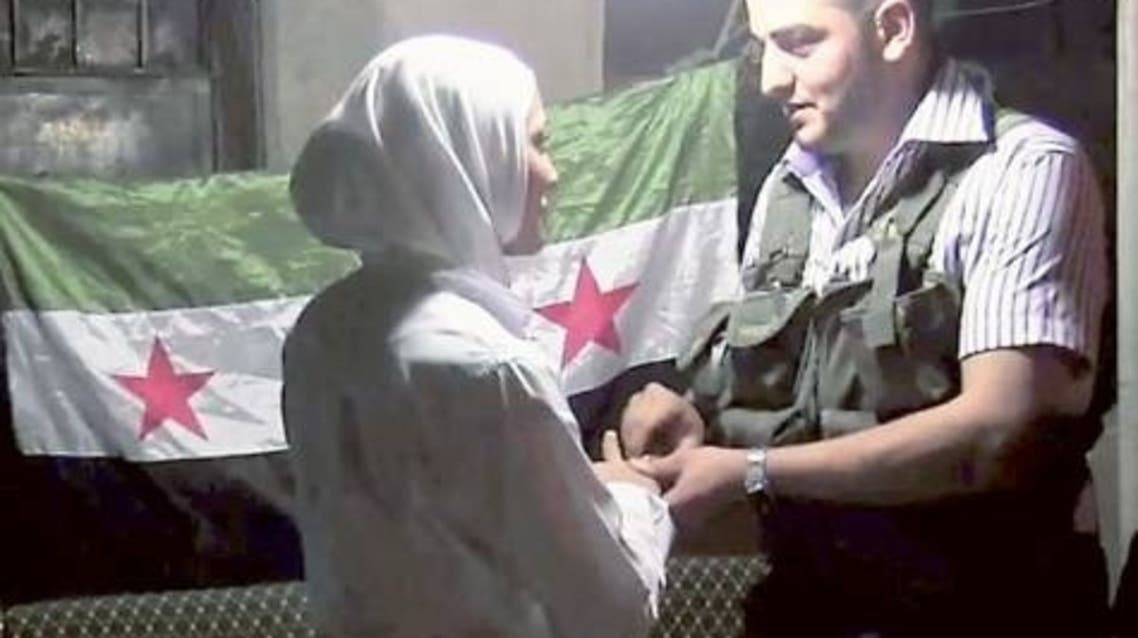 A picture showing a Syrian couple exchanging rings the Saif Al Dawla district of Aleppo. The young couple found love in a time of war. (File photo: AFP)