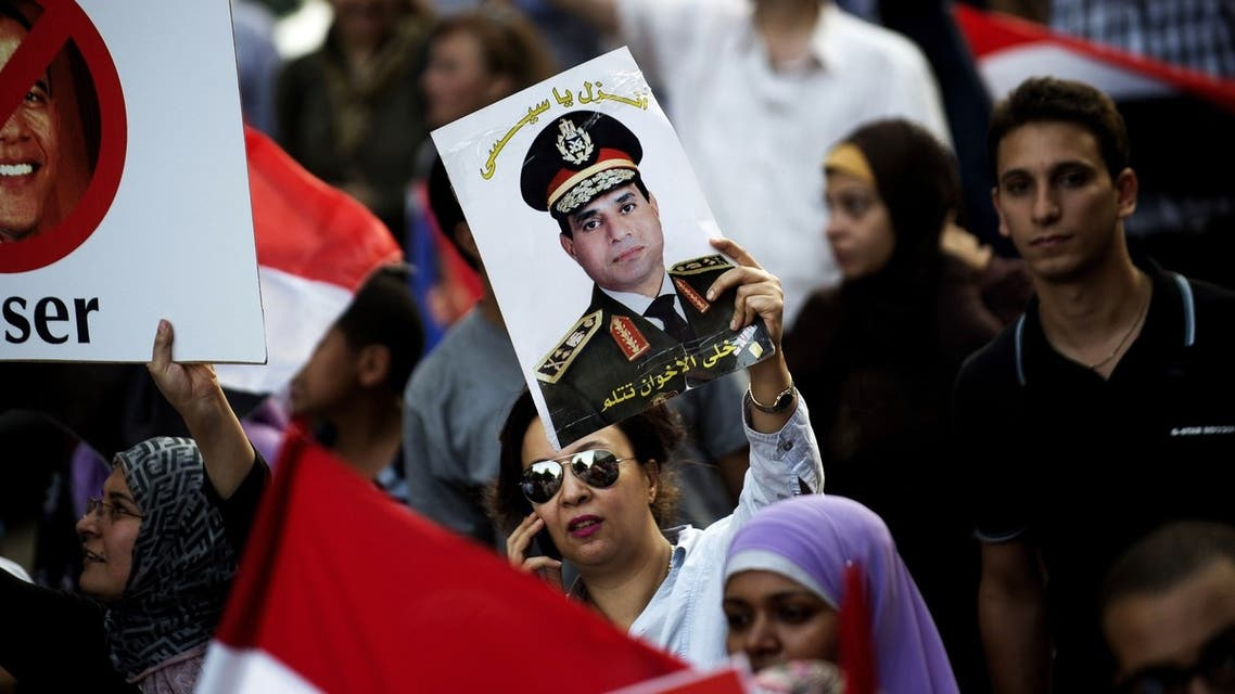 An Egyptian woman holds a portrait of Military Chief General Abdel fattah al-Sissi during a march towards Egypt's landmark Tahrir square against deposed President Mohammed Morsi on July 7, 2013 in Cairo, Egypt. (AFP)