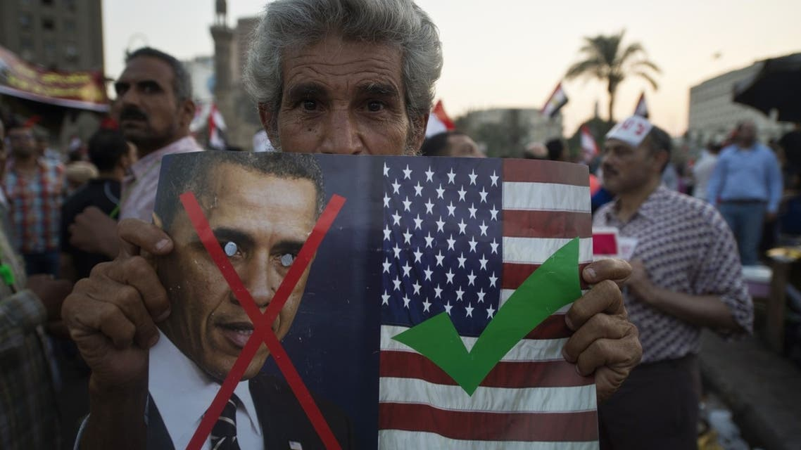 An Egyptian man holds an image of US President Barack Obama as they rally in Cairo's Tahrir Square, on July 7, 2013. (File photo: AFP)
