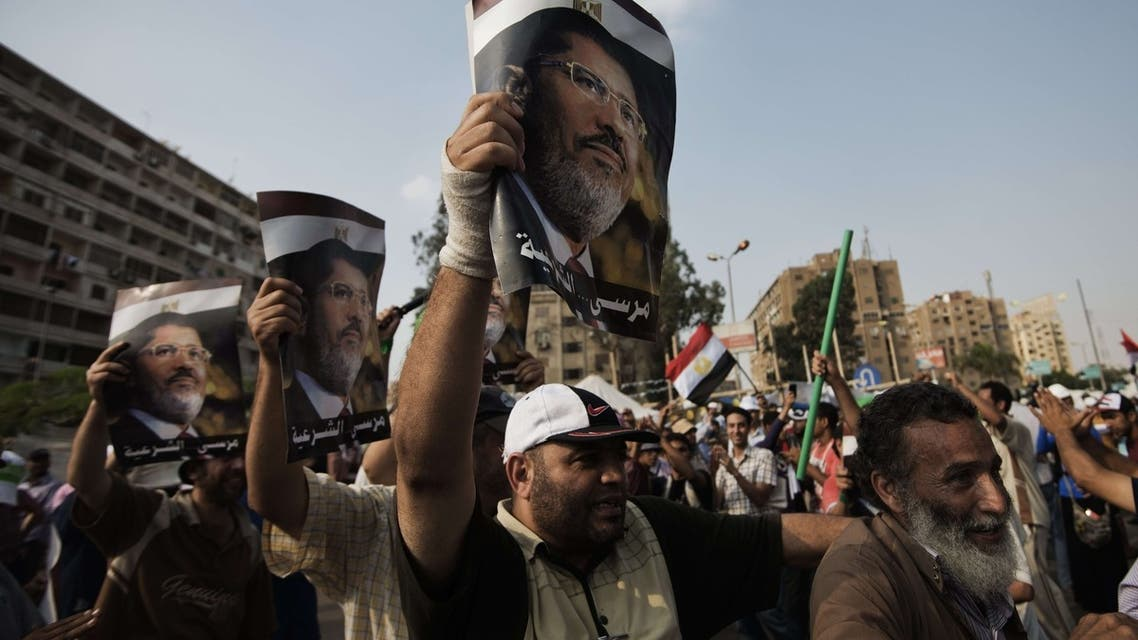 Supporters of ousted president Mohamed Mursi shout political and religious slogans as thousands gather in his support in front of Cairo's Rabaa al-Adawiya mosque on July 9, 2013. (File photo: AFP)