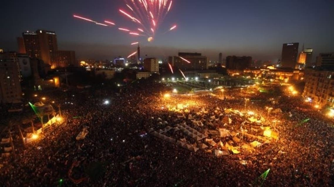 Protesters opposing Egyptian President Mohamed Mursi set off fireworks during a protest at Tahrir Square in Cairo June 30, 2013 (Reters)