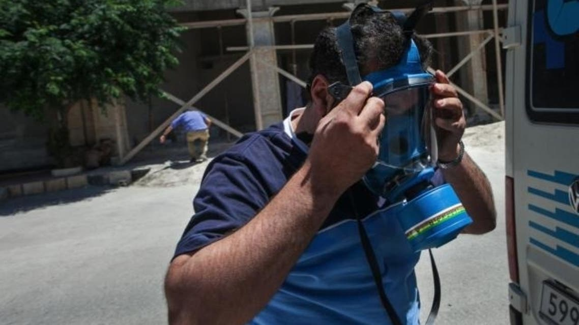 A picture shows an ambulance driver wearing a mask ahead of reports that chemical wepons were used in the northwestern province of Idlib. (File photo: AFP)