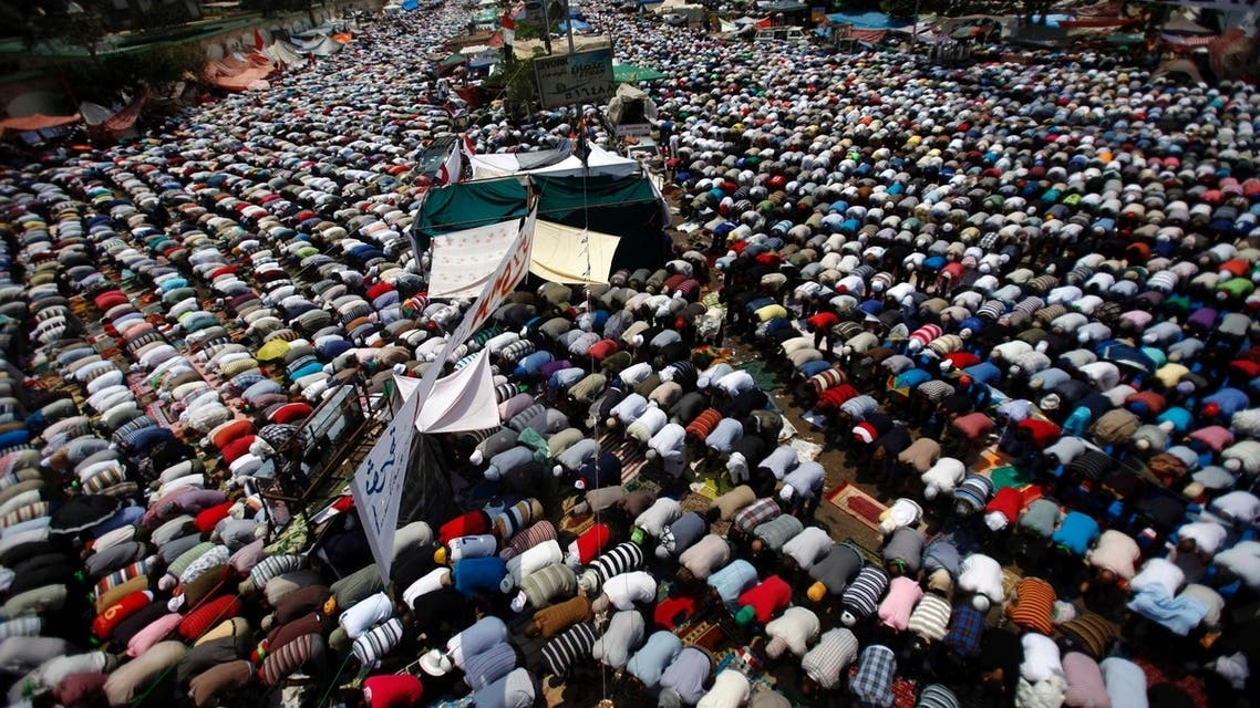 Supporters of ousted Egyptian President Mohamed Mursi perform weekly Friday prayers at the Rabaa Adawiya square, where they are camping, in Cairo July 12, 2013.