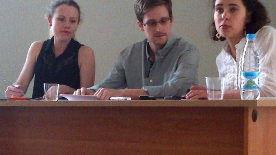 Former intelligence agency contractor Edward Snowden (C) and Sarah Harrison (L) of WikiLeaks speak to human rights representatives in Moscow's Sheremetyevo airport July 12, 2013. (Reuters)