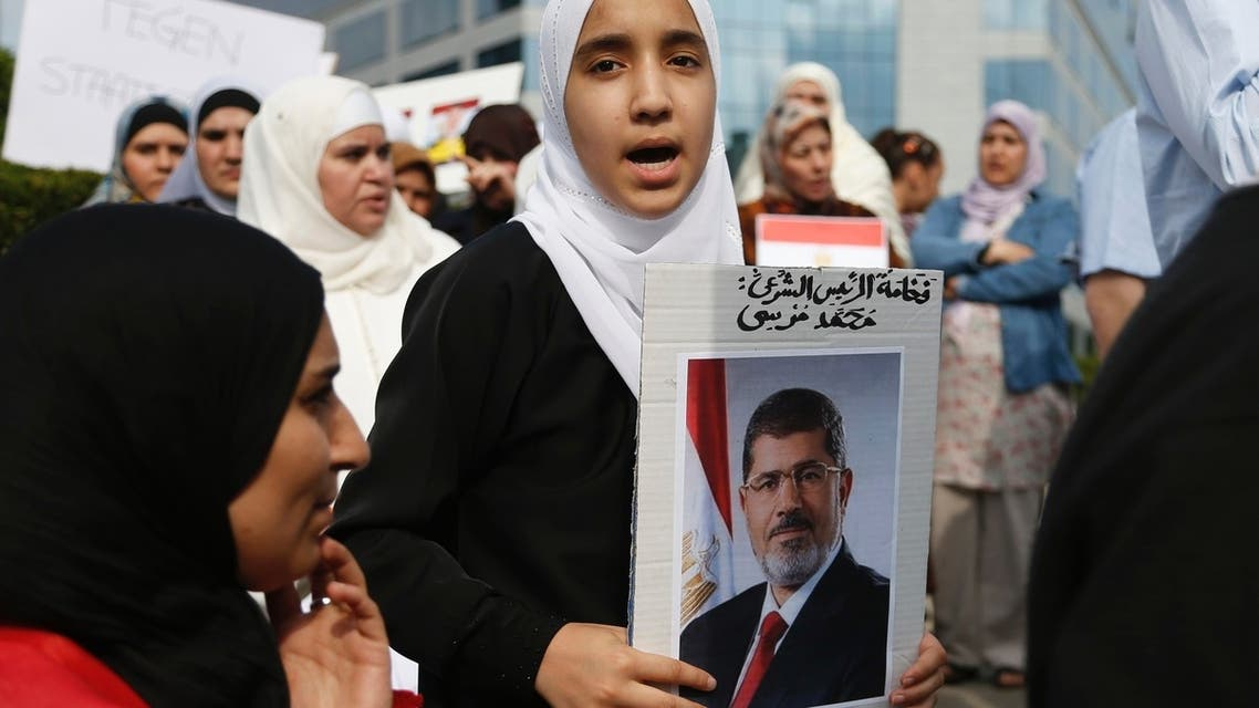 A supporter of ousted Egyptian President Mohamed Mursi chants slogans during a protest in front of the European Union Council building in Brussels July 12, 2013. (Reuters)