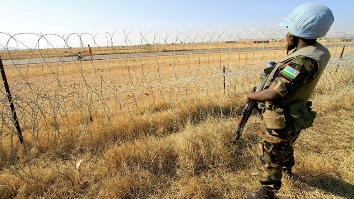 A Rwandan peacekeeper serving with the joint United Nations-African Mission in Darfur (UNAMID) stands guard in a field in Zalingei in western Darfur. (File Photo: AFP)
