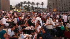 Muslims and Christians gather at Tahrir Square for Ramadan meal