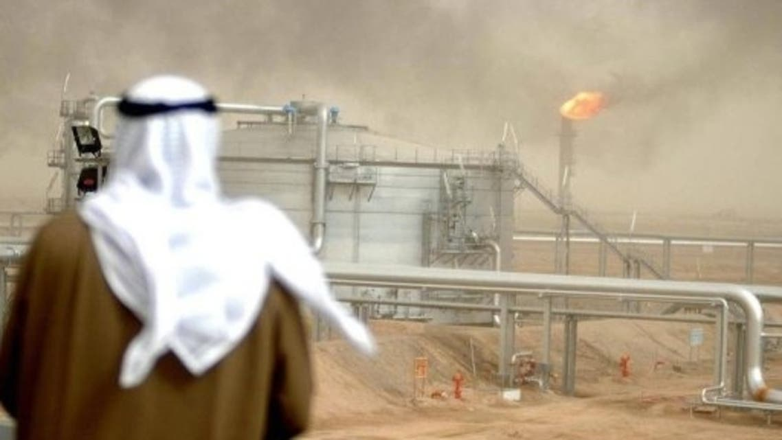 An employee of the Kuwait Oil Company (KOC) looks at the al-Rawdatain refinery. (File Photo: AFP)