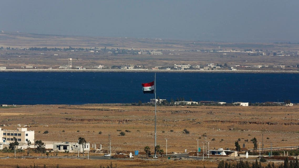 A Syrian flag flutters on the Syrian side of the ceasefire line between Israel and Syria near the Quneitra border crossing on the Israeli-occupied Golan Heights July 3, 2013. (Reuters)